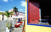 The colorful streets of Tlacotalpan. The colonial port of Tlacotalpan is one of the best preserved small cities in mexico, it has been declared a World Heritage town.  It is also the epicenter of the Cuban-Spanish influenced  Son Jarocho music.