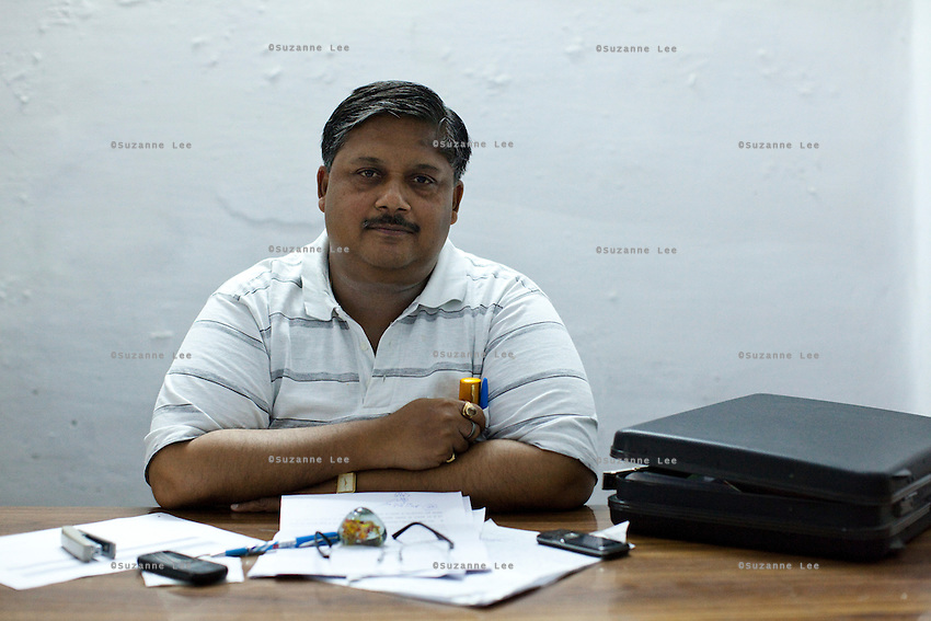 Dr. Sanjay Agarwal, Deputy Chief Medical Officer (CMO) of the Ghaziabad District, sits for a portrait in his office, a barren room furnished only by an empty table and a cabinet, in Ghaziabad, Uttar Pradesh, India. Photo by Suzanne Lee / Panos London
