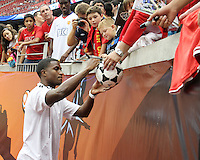 Edson Buddle #14 of the MLS All-Stars signs autographs before the 2010 MLS All-Star match against Manchester United at Reliant Stadium, on July 28 2010, in Houston, Texas. Manchester United won 5-2.