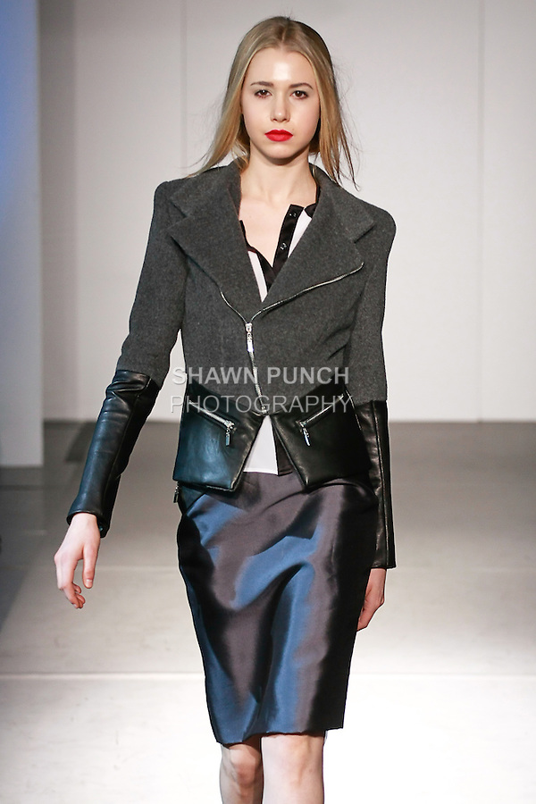 Model walks runway in an outfit from the Carlos Luna Fall 2012 collection, during Nolcha Fashion Week New York, February 9, 2012.