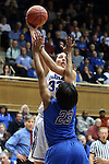 24 March 2014: Duke's Haley Peters (33) shoots over DePaul's Centrese McGee (23). The Duke University Blue Devils played the DePaul University Blue Demons in an NCAA Division I Women's Basketball Tournament Second Round game at Cameron Indoor Stadium in Durham, North Carolina. DePaul won the game 74-65.