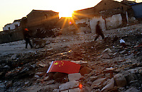 CHINA. Beijing. The ruins of an old hutong (traditional home) in the central Qianmen district, destroyed to make may for new developments aimed at modernising the city for the 2008 Summer Olympics. 2005