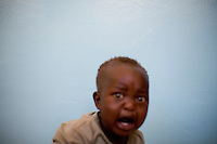 A young Kenyan boy at endebess IDP camp in Kenya following post election violence in 2008..