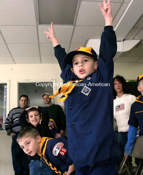 WATERTOWN, CT. 19 FEBRUARY 2006- 021906BZ02- Michael Cullen, 7, Den 6, Pack 55, cheers as his car crosses the line in first place during a heat race at a Pinewood Derby held at the United Methodist Church Sunday afternoon. Looking on at left are Robbie Cullen and Peter Doback, 7.<br /> Jamison C. Bazinet / Republican-American