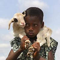 Fulani Boy and Goat. Kajuru, Kaduna State, Nigeria.