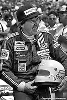 INDIANAPOLIS, IN: Tom Sneva pauses in the pit lane after qualifying his McLaren M24/Cosworth TC on the pole position for the Indianapolis 500 on May 29, 1977, at the Indianapolis Motor Speedway.