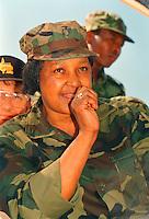 Winnie Mandela in military uniform.