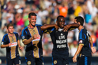 Amobi Okugo (14) of the Philadelphia Union celebrates scoring with Sebastien Le Toux (11). The Philadelphia Union and FC Dallas played to a 2-2 tie during a Major League Soccer (MLS) match at PPL Park in Chester, PA, on June 29, 2013.
