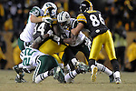PITTSBURGH, PA - JANUARY 23: Rashard Mendenhall #34 of the Pittsburgh Steelers is tackled by members of the against the New York Jets defense in the AFC Championship Playoff Game at Heinz Field on January 23, 2011 in Pittsburgh, Pennsylvania(Photo by: Rob Tringali) *** Local Caption *** Rashard Mendenhall