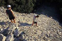 Tourists climbing the Great Pyramid or Nohoch Mul (Great Mound) at the Mayan ruins of Coba, Quintana Roo, Mexico.This is the tallest (42 metres) Mayan structure on the Yucatan peninsula.