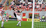 Derek Riordan curls in a screamer of a goal whch beats keeper Tomas Cerny and Martin Canning