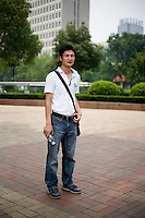 Chenhuazhu, a manager, age 26, poses for a portrait in Nanjing. Response to 'What does China mean to you?': 'China is my ancestral land. I like my homeland.'  Response to 'What is your role in China's future? or What is China's role in the future?': '[no answer]'