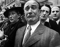 A Frenchman weeps as German soldiers march into the French capital, Paris, on June 14, 1940, after the Allied armies have been driven back across France.  (OWI)<br /> NARA FILE #:  208-PP-10A-3<br /> WAR &amp; CONFLICT BOOK #:  997