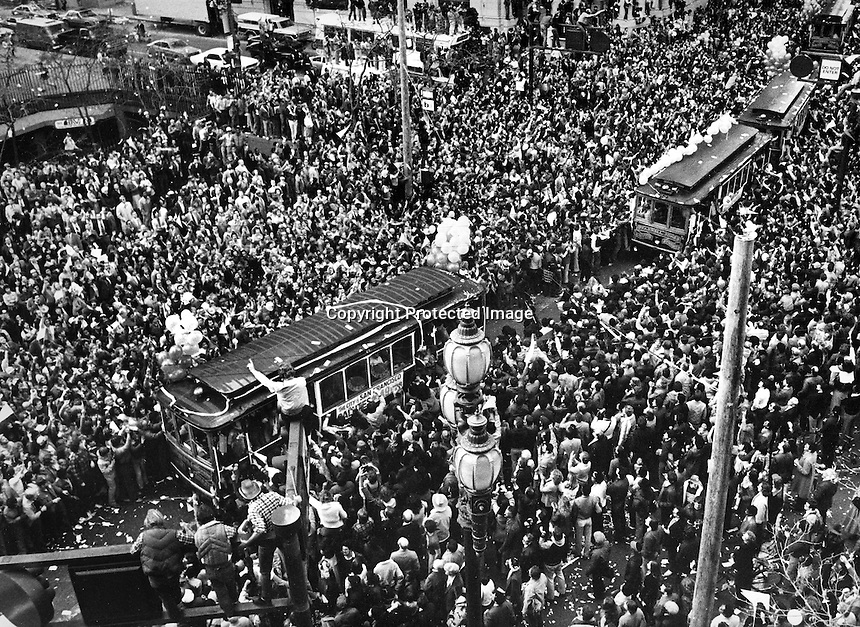 San Francisco 1982: The San Francisco 49ers parade accross Market St. in downtown San Francisco with throngs of fans lining the route. The niners defeated the Maimi Dolphins in the Super Bowl.<br />(photo/Ron Riesterer)