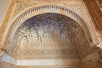 Moorish architectural sculpted plasterwork of the Palacios Nazaries, Alhambra. Granada, Andalusia, Spain.
