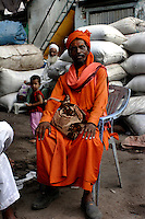A Hindu sadhu looks towards the camera on 21st Oct 2006. Dharavi is celebrated as a community of different faiths.