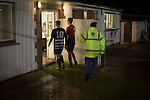 Gretna 0 Dalbeattie Star 0, 11/03/2016. Raydale Park, Lowland League. Two opposing players walking towards the dressing rooms at Raydale Park, after Gretna (in stripes) took on Dalbeattie Star in a Scottish Lowland League fixture which ended 0-0. The match was one of six arranged by the league and GroundhopUK over the weekend to accommodate groundhoppers, fans who attempt to visit as many football venues as possible. Around 100 fans in two coaches from England participated in the 2016 Lowland League Groundhop and they were joined by other individuals from across the UK which helped boost crowds at the six featured matches. Photo by Colin McPherson.