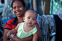 A women receives medicines for her child in Panagatan. After Typhoon Yolanda (Haiyan) did lots of damage on the island there was also a Chikungunya outbreak.