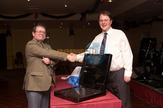Presentation at the Drogheda Independent Christmas party  Tommy Harding and Martin Gary Production Manager..Pic Fran Caffrey Newsfile..Camera:   DCS620C.Serial #: K620C-01974.Width:    1728.Height:   1152.Date:  11/12/99.Time:   23:05:56.DCS6XX Image.FW Ver:   1.9.6.TIFF Image.Look:   Product.Counter:    [650].Shutter:  1/40.Aperture:  f5.6.ISO Speed:  400.Max Aperture:  f3.5.Min Aperture:  f22.Focal Length:  24.Exposure Mode:  Manual (M).Meter Mode:  Color Matrix.Drive Mode:  Continuous High (CH).Focus Mode:  Single (AF-S).Focus Point:  Center.Flash Mode:  Normal Sync.Compensation:  +0.0.Flash Compensation:  +0.0.Self Timer Time:  10s.White balance: Auto (Flash).Time: 23:05:56.981.
