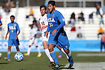 14 December 2014: UCLA's Edgar Contreras (30) and Virginia's Riggs Lennon (12). The University of Virginia Cavaliers played the University of California Los Angeles Bruins at WakeMed Stadium in Cary, North Carolina in the 2014 NCAA Division I Men's College Cup championship match. Virginia won the championship by winning the penalty kick shootout 4-2 after the game ended in a 0-0 tie after overtime.