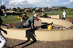 SOWETO, SOUTH AFRICA DECEMBER 10: Young Black Yuppies play as they have a barbeque on December 10, 2006 in Soweto, Johannesburg, South Africa. They are on Thokoza Park, a popular area for picnics and to relax during the weekends. Many wedding couples come here to have their pictures taken also. Soweto is South Africa?s largest township and it was founded about one hundred years to make housing available for black people south west of downtown Johannesburg. The estimated population is between 2-3 million. Many key events during the Apartheid struggle unfolded here, and the most known is the student uprisings in June 1976, where thousands of students took to the streets to protest after being forced to study the Afrikaans language at school. Soweto today is a mix of old housing and newly constructed townhouses. A new hungry black middle-class is growing steadily. Many residents work in Johannesburg but the last years many shopping malls have been built, and people are starting to spend their money in Soweto.  .(Photo by Per-Anders Pettersson/Getty Images) .