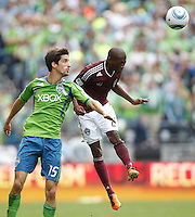 Seattle Sounders FC midfielder Alvaro Fernandez, left, Colorado Rapids forward Sanna Nyassi battle for the ball during play at CenturyLink Field in Seattle Saturday July 16, 2011. The Sounders won the game 4-3.