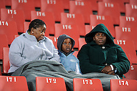 Local fans keep warm under a blanket on a cold night. Iraq and New Zealand tied 0-0 during the FIFA Confederations Cup at Ellis Park Stadium in Johannesburg, South Africa on June 20, 2009..