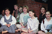 """Performing on stage.  Drama group for 8-13s rehearsing a production of """"Alice"""" in the Mill Studio at the Yvonne Arnaud Theatre, Guildford, Surrey."""