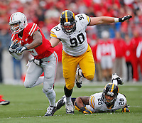 Ohio State Buckeyes quarterback Braxton Miller (5) eludes Iowa Hawkeyes defensive lineman Louis Trinca-Pasat (90) and Iowa Hawkeyes linebacker Christian Kirksey Stadium on October 19, 2013.  (Chris Russell/Dispatch Photo)