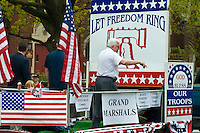 Grand marshal float at  Loyalty day patriotic parade in small town USA.