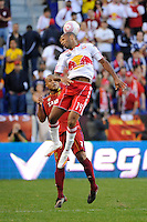 Thierry Henry (14) of the New York Red Bulls goes up for a header over Robbie Russell (3) of Real Salt Lake. The New York Red Bulls and Real Salt Lake played to a 0-0 tie during a Major League Soccer (MLS) match at Red Bull Arena in Harrison, NJ, on October 09, 2010.