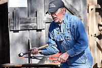 NWA Democrat-Gazette/FLIP PUTTHOFF <br /> BLACKSMITH AT WORK<br /> Joe Doster of Huntsville hammers red-hot metal into a tool Saturday March 18 2017 during his blacksmith demonstration at the Shiloh Museum of Ozark History in Springdale. Doster heated metal on his coal-fired forge to make tools and nails during his presentation, and showed tools of the blacksmith's trade.