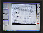 A computer screen shows a document being scanned in the Project to Recover the Historical Archives of the National Police of Guatemala, where workers are sorting through and cataloging 80 million pages of records that detail the Central American country's history of repression and violence.