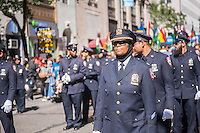 Corrections officers of the Muslim faith march on Madison Avenue in New York on Sunday, September 25, 2016 in the American Muslim Parade. The annual parade, now in it's 31st year, celebrates the diversity and heritage of Islamic culture. Participants march down Madison Avenue ending in a street fair. (© Richard B. Levine)