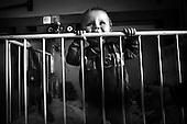 Wroclaw 02.02.2007 Poland.<br /> Kamil Ochrymczuk in his first birthday.<br /> Clinical Hospital, oncology and haematology departmend. This is one of the important Haematologic Hospital in all over Poland, however hospital board stopped to discharge a rising debt. In this connection authorities must close hospital, but goverment had no idea what should do with terminaly ill children.<br /> (Photo: Adam Lach / Napo Images)<br /> <br /> Kamil Ochrymczuk w dniu swoich 1 urodzin w lozeczku w swojej sali na oddziale hematologicznym.<br /> Akedemicki Szpital Kliniczny, oddzial onkologii i hematologii. Temu jednemu z najwazniejszych w Polsce osrodkowi szpitalnemu grozi zamkniecie w powodu dlugow, ktore niezaleznie od wplat NFZ-tu regularnie sciaga komornik. Z calej Polski ludzie charytatywnie wplacaja pieniadze by uratowac szpital i los dzieci dla ktorych to miejsce jest jedynym ratunkiem.