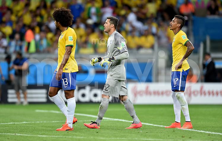FUSSBALL WM 2014                HALBFINALE Brasilien - Deutschland          08.07.2014 Dante, Torwart Julio Cesar  und Luiz Gustavo (v.l., alle Brasilien) sind enttaeuscht
