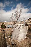 Leaning wooden outhouse, Unionville, Nevada