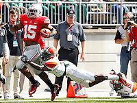 Ohio State Buckeyes running back Ezekiel Elliott (15) is taken down by Florida A&M Rattlers defensive back Jules Dornevil (41) after a long run in the 3rd quarter during their college football game at Ohio Stadium on September 21, 2013.  (Dispatch photo by Kyle Robertson)