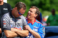 May 16, 2014; Commerce, GA, USA; NHRA pro stock driver Jason Line (left) with Larry Morgan during qualifying for the Southern Nationals at Atlanta Dragway. Mandatory Credit: Mark J. Rebilas-USA TODAY Sports
