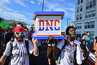 "Philadelphia, PA - July 26, 2016: Several people hold a makeshift casket marked with ""DNC"" and democratic and republican logos as they march with a large group down South St. to City Hall in Philadelphia, PA. during the Democratic National Convention, July 26, 2016.  (Photo by Don Baxter/Media Images International)"
