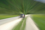 Movement of car travelling along country lane. The Austrian Alps