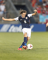 USMNT midfielder Mix Diskerud (8) controls the ball. In CONCACAF Gold Cup Group Stage, the U.S. Men's National Team (USMNT) (blue/white) defeated Costa Rica (red/blue), 1-0, at Rentschler Field, East Hartford, CT on July 16, 2013.