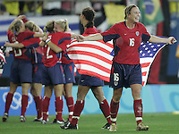 26 August 2004: Abby Wambach celebrates with the team after winning the Gold Medal game against Brazil at Karaiskakis Stadium in Athens, Greece.  Credit: Michael Pimentel / ISI.
