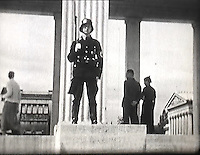 BNPS.co.uk (01202 558833)<br /> Pic: Mullocks/BNPS<br /> <br /> Hitler's new headquarters in Munich with a memorial to the victims of 18th November 1923 revolution.<br /> <br /> A remarkable film of David Lloyd George's visit to Germany to meet Adolf Hitler in 1936 after which he described him as 'the greatest living German' has emerged for auction.<br /> <br /> The unique black and white 16mm film which lasts 20 minutes shows former Prime Minister Lloyd George and his entourage twice meeting Hitler and driving along newly created autobahns.<br /> <br /> The grainy footage captures Lloyd George with Hitler at a dinner party, him laying a wreath at a war memorial in Munich and the alarming sight of the Nazi and United Kingdom flags hanging together on a German building.<br /> <br /> The film belongs to a British historian with a large collection of archive footage and is tipped to sell for &pound;1,200.