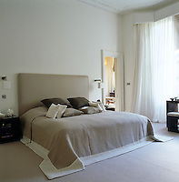 A sophisticated tranquil bedroom is decorated in natural colours and fabrics