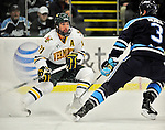 30 October 2010: University of Vermont Catamount forward Jack Downing, a Senior from New Canaan, CT, in action against the University of Maine Black Bears at Gutterson Fieldhouse in Burlington, Vermont. The Black Bears defeated the Catamounts 3-2 in sudden death overtime. Mandatory Credit: Ed Wolfstein Photo