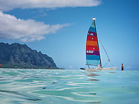 Looking at Kualoa from sand bar. Hobie Cat sailboat  anchored at Kaneohe Bay sandbar.