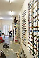 The artist Richard Woods has built a timber house where he can both create and showcase his bold, bright work.  Richard at work in the house. Wood's workshop is flooded with light from large windows to the front and back. Woods prepares canvases for a show.