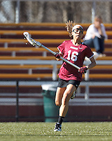 Harvard University midfielder Mariel Jenkins (16) brings the ball forward.
