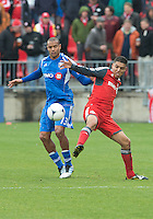 20 October 2012: Montreal Impact defender Matteo Ferrari #13 and Toronto FC midfielder Luis Silva #11in action during an MLS game between the Montreal Impact and Toronto FC at BMO Field in Toronto, Ontario Canada. .The ended in a 0-0 draw..